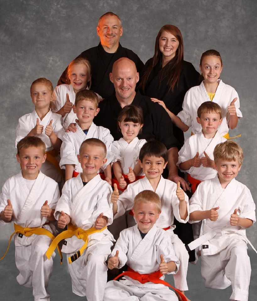Mr. Christensen with karate kids and adults